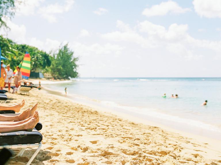 Beach goers with sandy feet on Mullins Beach, Barbados