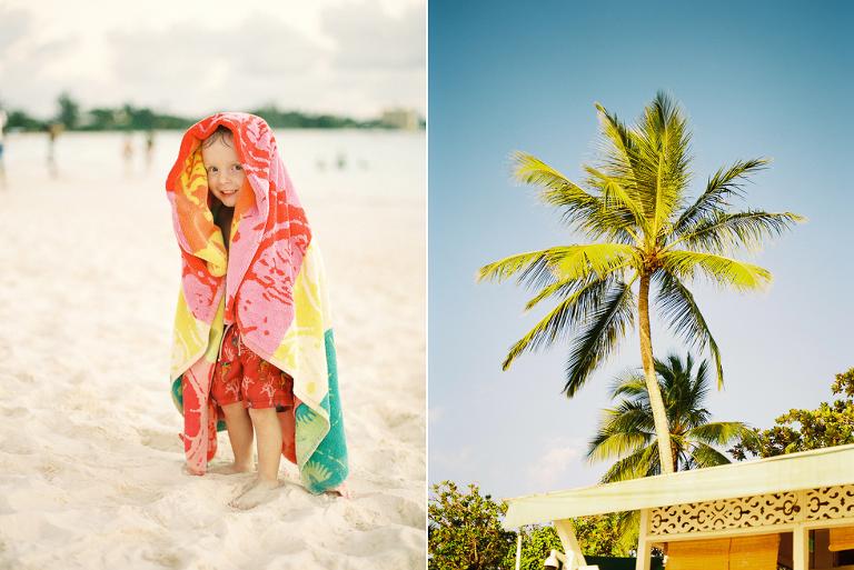 Boy wrapped in a towel on a beach in Bridgetown, Barbados