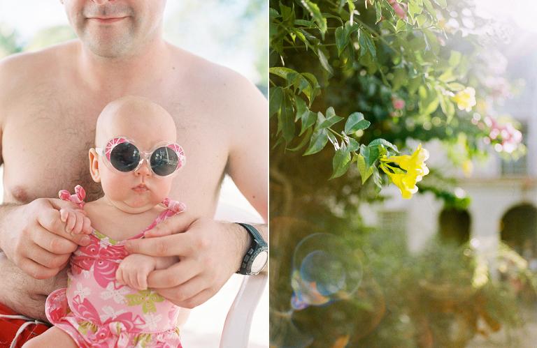 baby girl in huge sunglasses at Lobster Alive in Bridgetown Barbados